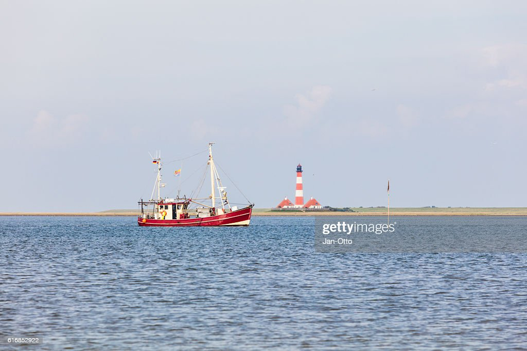 Fishing boat in front of Westerhever, Germany : Stock Photo