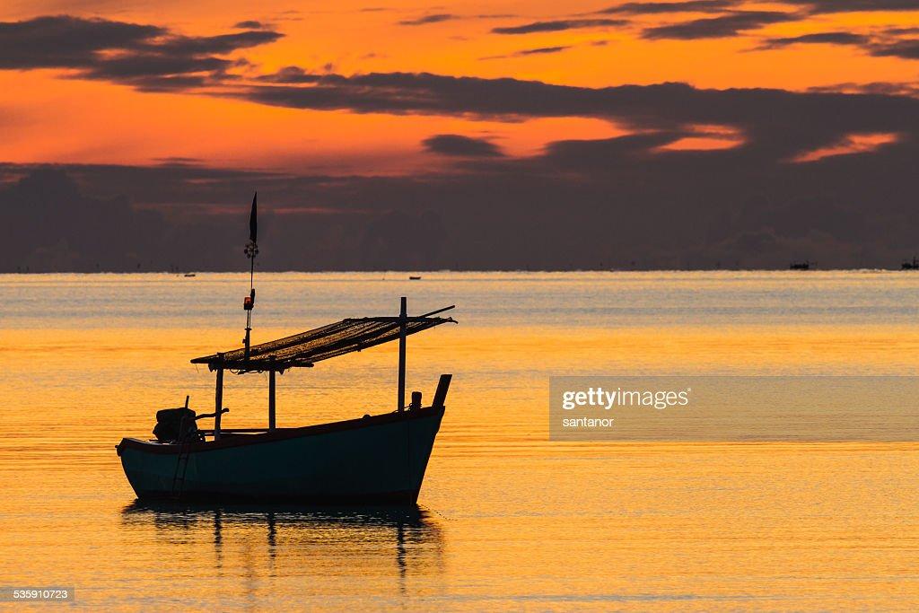 Fishing boat in sunrise mood : Stock Photo