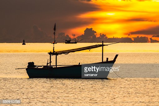 Fishing boat in sunrise mood : Stock Photo