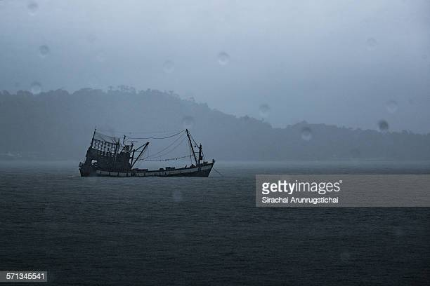 A fishing boat in the stormy sea