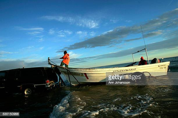 A fishing boat moves on to a trailer pulled by a truck in Golfo de Santa Clara Baja California in Mexico Fishermen from this area fish in the Sea of...