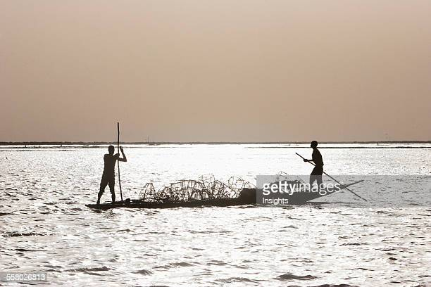 Fishing boat on Lake Debo formed by the seasonal flooding of the Niger River Mali