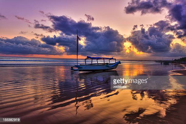 Fishing Boat on the Beach at Sunrise