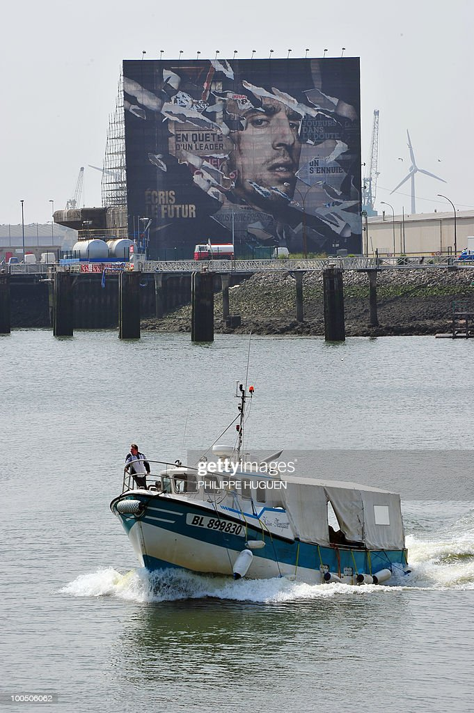 A fishing boat sails in front of a 800 m2 portrait of French football international Franck Ribery on May 25, 2010 in the northern city of Boulogne-sur-Mer, the place where the 27-year-old player of the Bayern's Munich was born. The project faced controversy when the Northern Pas-de-Calais region called to stop it after Ribery was questioned by French police on the under-age call-girl scandal which has rocked the France football team.
