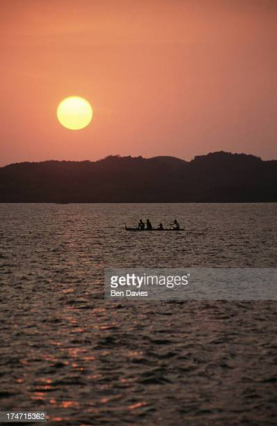 LINGAYEN PANGASINAN PHILIPPINES A fishing boat silhouetted against the sea at sunset in the Gulf of Lingayen in the Philippines This region is famous...