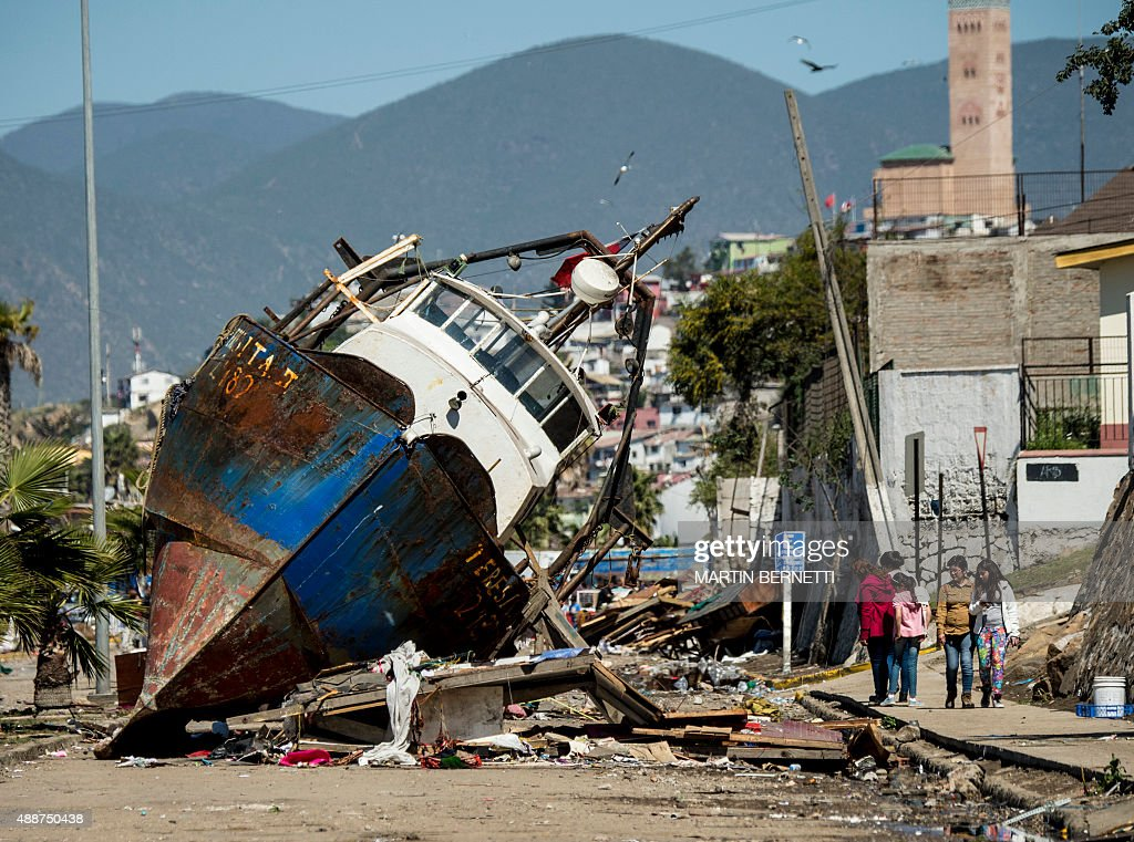 A fishing boat that was ran aground by the sea while moored in the port of Coquimbo some 445 km north of Santiago during the eve's earthquake on...