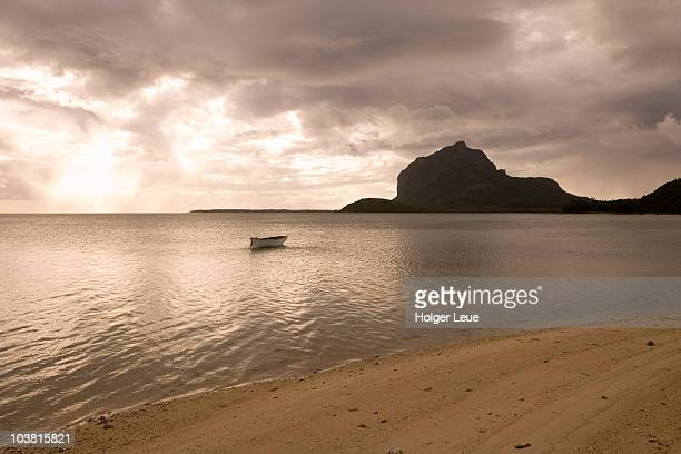 Fishing boat with Le Morne Brabant mountain in background.