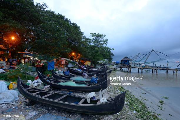 Fishing boats and Chinese fishing nets in Kochi during the monsoon state of Kerala on July 19 2016 in India