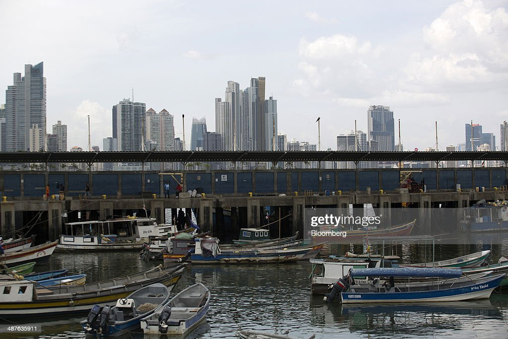 Fishing boats are anchored near the fish market as buildings stand in the skyline in the background in Panama City, Panama, on Wednesday, April 23, 2014. Panama has averaged about 9 percent economic growth annually since 2008 and unemployment levels hover near a record low of 4.1 percent. Photographer: Susana Gonzalez/Bloomberg via Getty Images