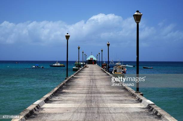Fishing boats are docked at a jetty in Bridgetown Barbados on May 4 2015 AFP PHOTO/JEWEL SAMAD