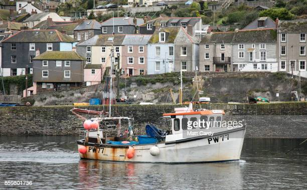 Fishing boats are seen in the harbour in the village of Mevagissey which has submitted plans to limit the number of second homes on October 10 2017...