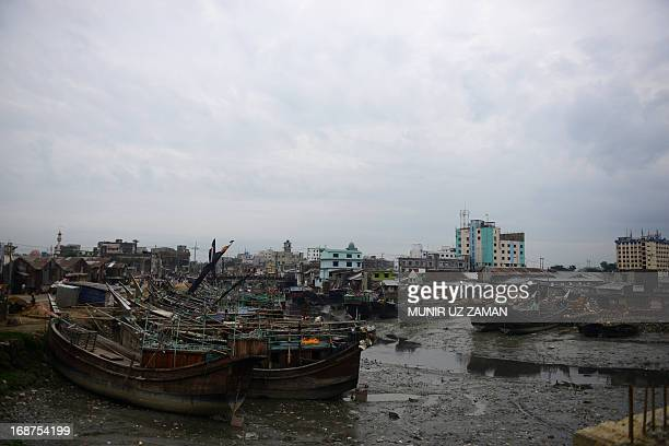 Fishing boats are tied up in the harbour of Chittagong on May 15 2013 during preparations for the expected arrival of Cyclone Mahasen Cyclone Mahasen...