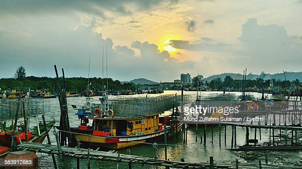 Fishing Boats At Harbor Against Sky During Sunset