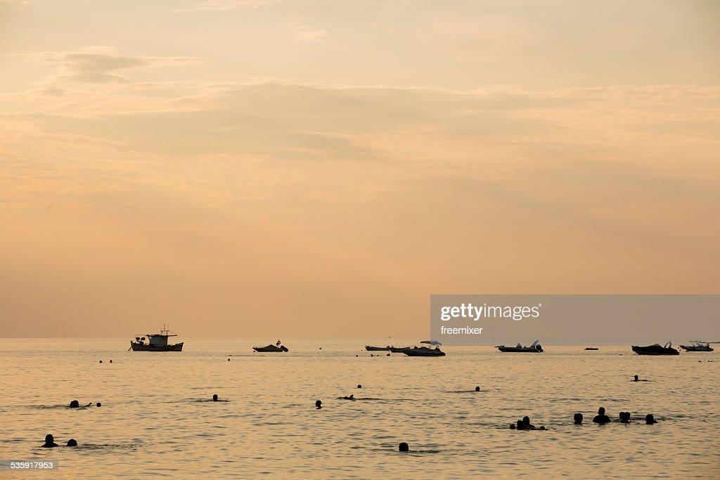 Fishing boats at sea at sunset : Stock Photo