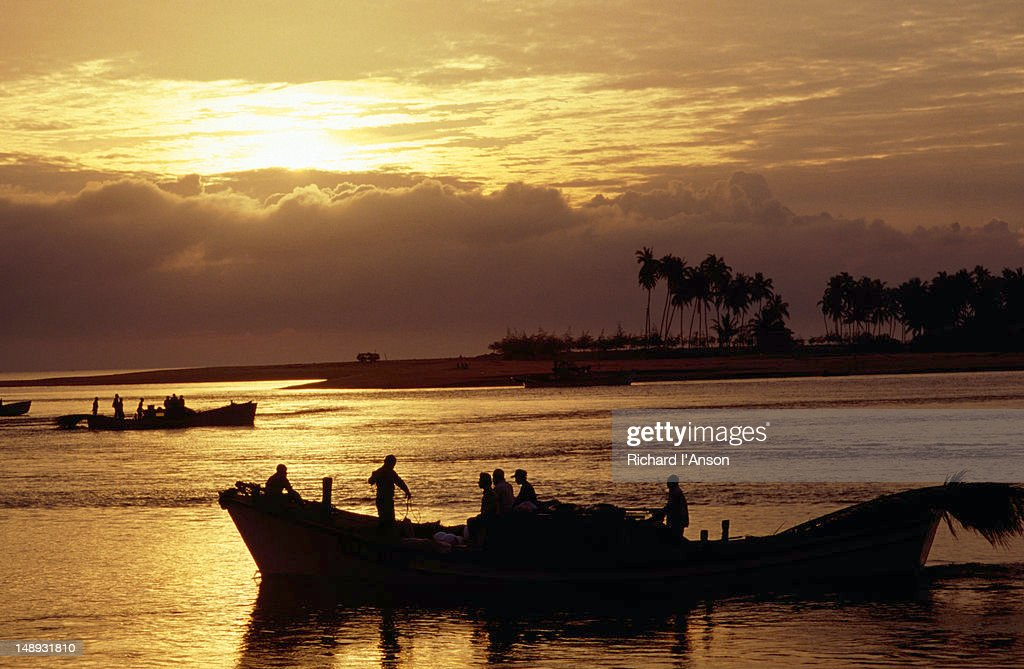 Fishing boats at sunrise.