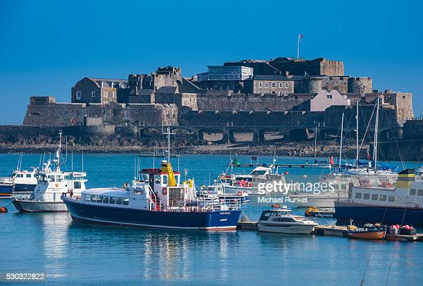 Fishing boats below Cornet castle, Saint Peter Port, Guernsey, Channel Islands, United Kingdom, Europe