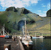 Fishing boats dock at the port of Heimaey Vestmann Islands Iceland