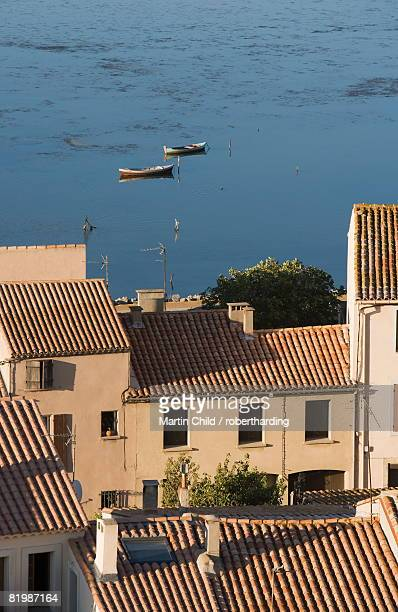 Fishing boats, Etang de L'Ayrolle, view of rooftops from Barbarossa tower, Gruissan, Golfe du Lion, Aude, Languedoc-Roussillon, France, Europe