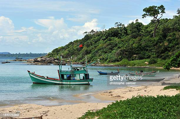 Fishing boats in cove and beach