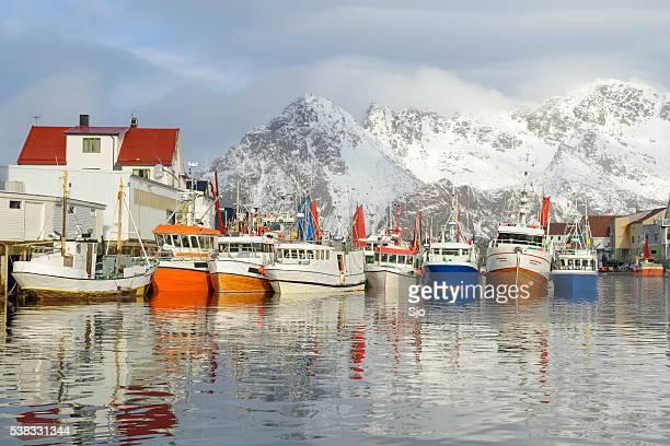 Fishing boats in Henningsvaer in winter in the Lofoten, Norway