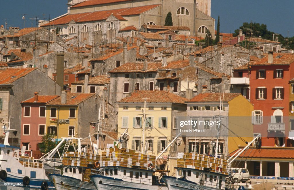 Fishing boats in port and buildings. : Stock Photo