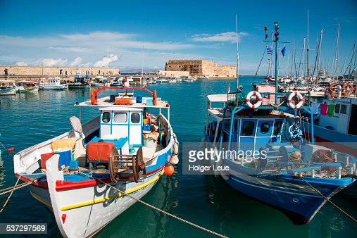 Fishing boats in port with Koules Fortress behind