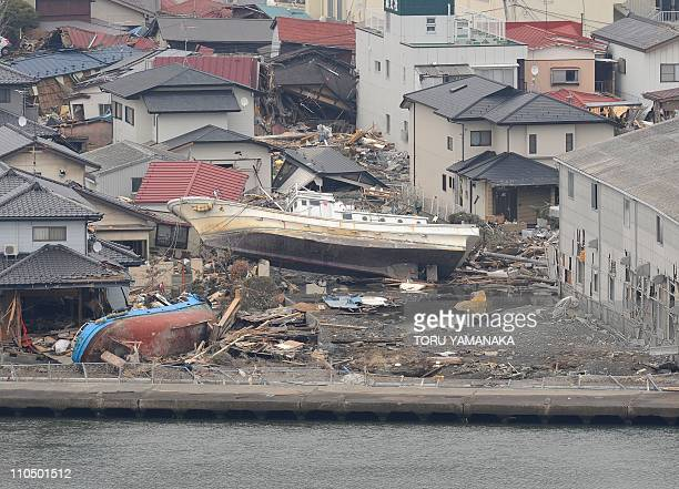Fishing boats lie scattered amid the debris of houses 10 days after the massive 90 earthquake and tsunami in Ishinomaki Miyagi prefecture on March 21...