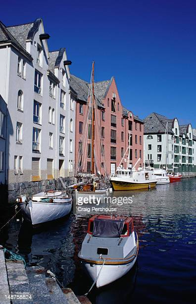 Fishing boats moored on the picturesque Brosundet canal at Alesund in the Western Fjords region.