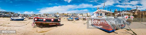Fishing boats moored seaside beach harbour panorama St Ives Cornwall