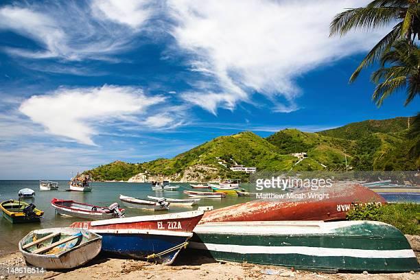 Fishing boats on beach.