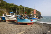 Fishing boats on the beach at the historic and attractive fishing village of Cadgwith Cove on the Lizard Peninsula Cornwall England
