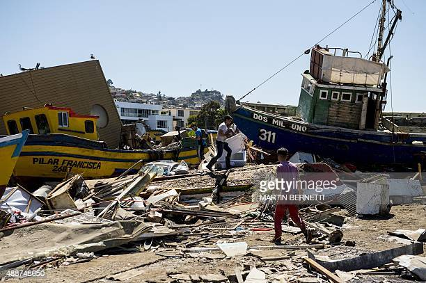 Fishing boats that were ran aground by the sea while berthed in the port of Coquimbo some 445 km north of Santiago during the eve's earthquake on...