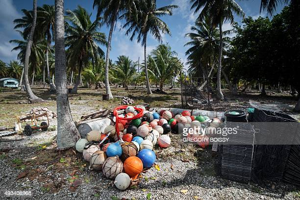 Fishing bobbers and floats spoil the shoreline of the Toau atoll about 400 kilometres from Tahiti in the Tuamotu Archipelago in the French polynesia...