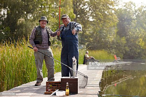 Fishing buddies with freshly caught fish