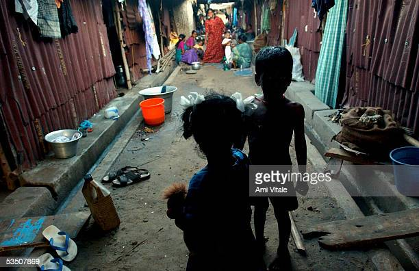 Fishing families from Akkrapattai beach sit in the cramped temporary shelters on August 28 2005 in Nagapattinum district in Tamil Nadu India The...