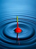 Fishing float in rippling water