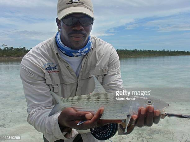 Fishing guide Alvin Greene holds a bonefish near central Andros Island in the Bahamas