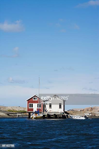Fishing huts by the ocean Smogen Bohuslan Sweden.