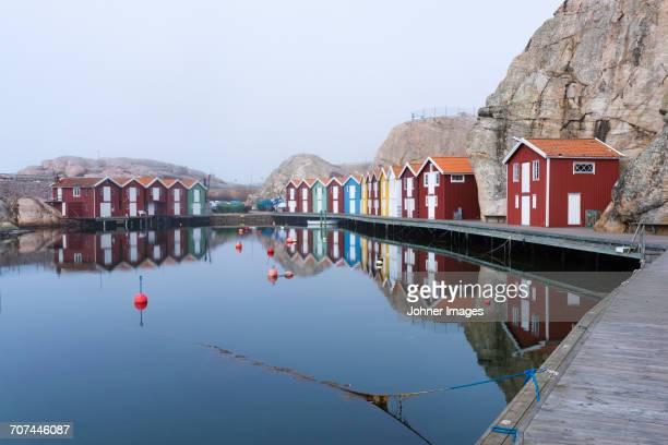 Fishing huts reflecting in water