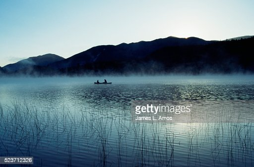 Fishing in early morning fog stock photo getty images for Nys fishing license prices