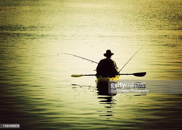Fishing man in kayak