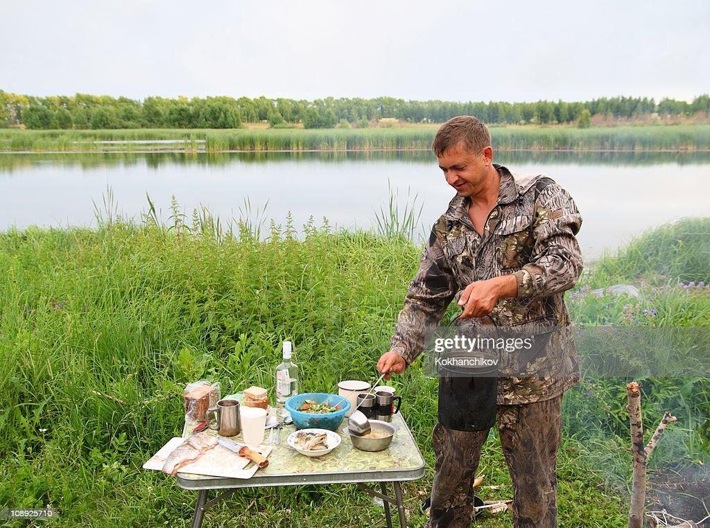 Fishing Man Prepare Fish Soup Stock Photo