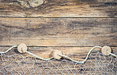 Fisher net on rustic wooden background texture with copy space