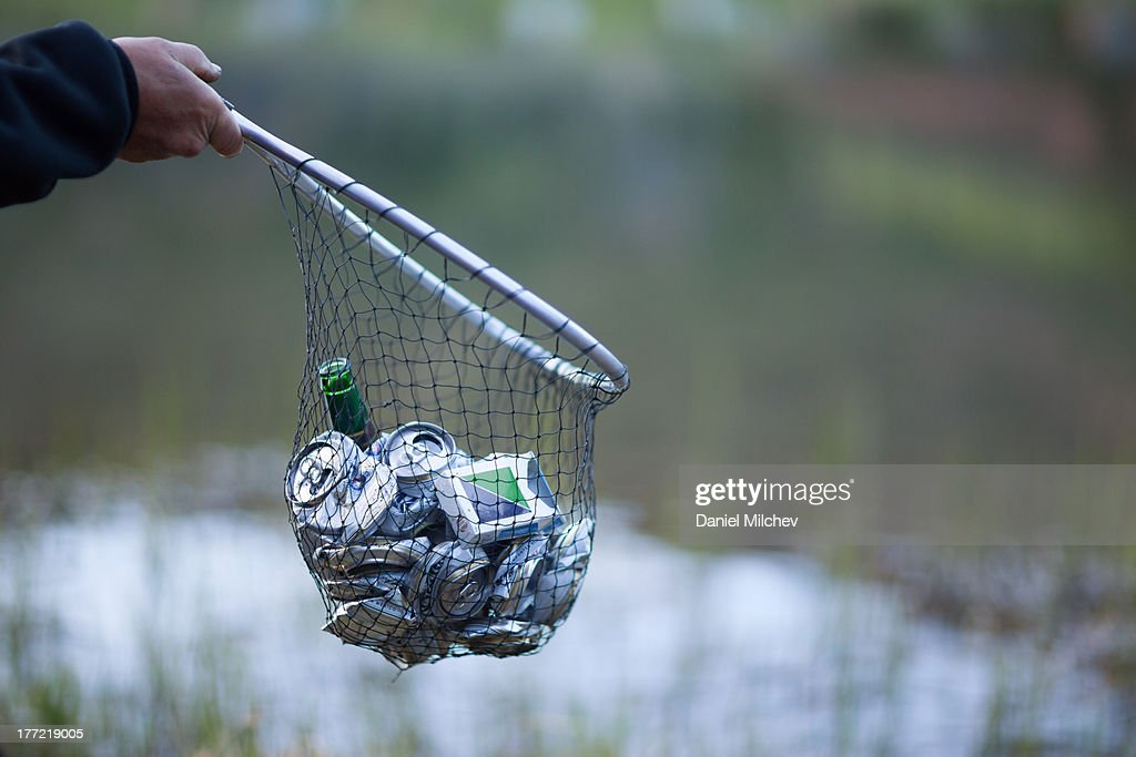 Fishing net full of trash. : Stock Photo