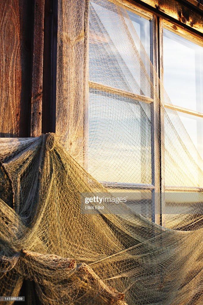 Fishing nets drying on boathouse