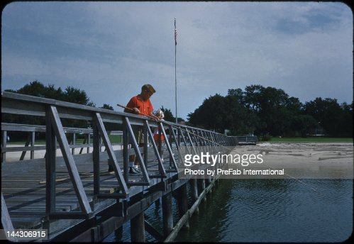 Fishing on pier : Stock Photo
