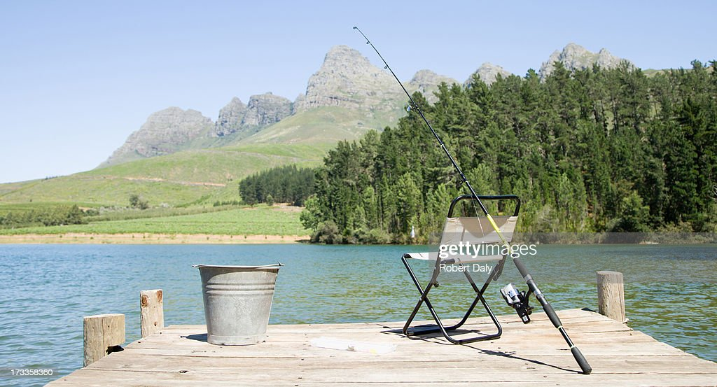 Fishing pole and chair on dock