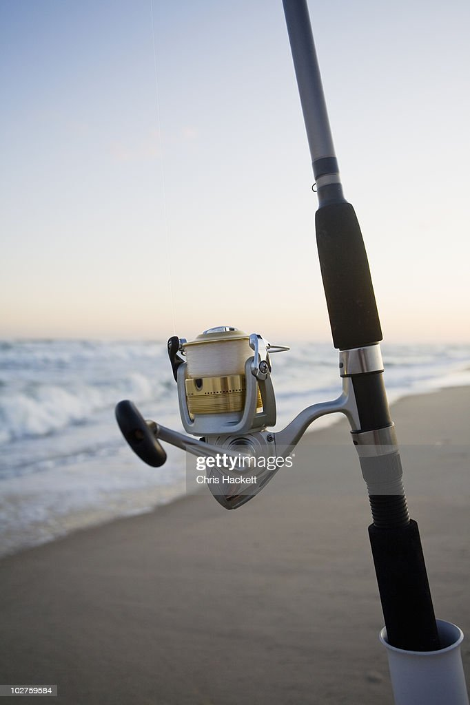 Fishing pole on the beach stock photo getty images for Ma fishing license cost