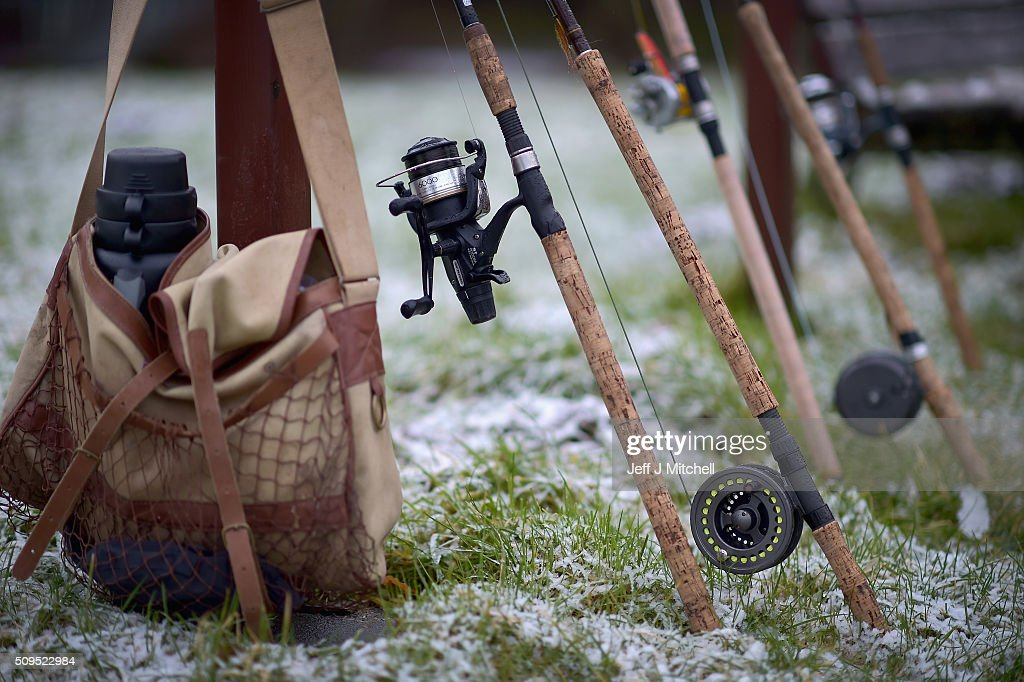 FIshing poles are ready during the opening day of the salmon season on the River Spey on February 11, 2016 in Aberlour, Scotland. The annual opening day ceremony took place at Penny Bridge, with the traditional pouring of a bottle of Aberlour twelve year old single malt Scotch whisky into the river.