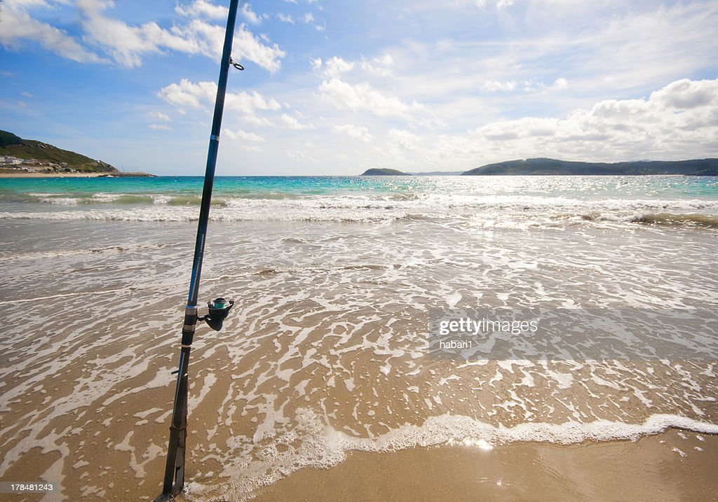 Fishing rod on a spanish beach stock photo getty images for Fishing rod in spanish